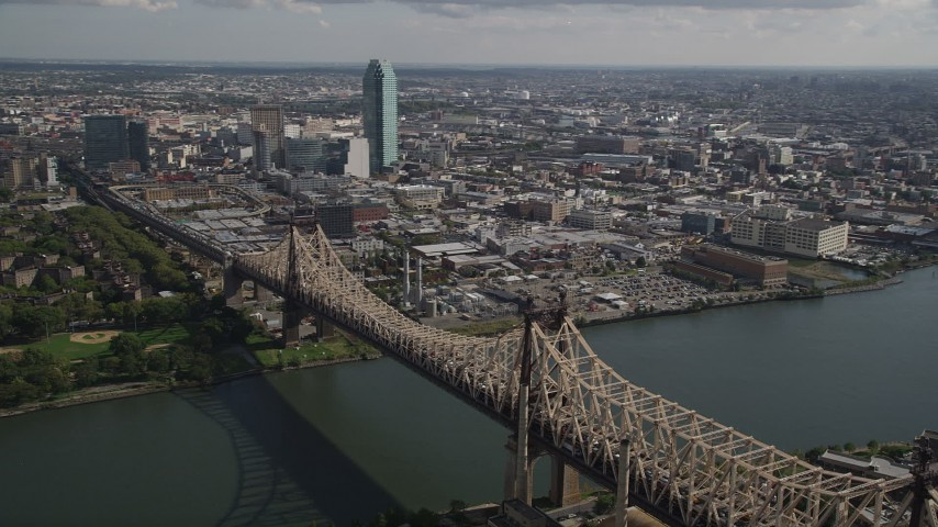 4K stock footage aerial video Flying by Queensboro Bridge spanning East River, Queens, New York, New York Aerial Stock Footage | AX87_189