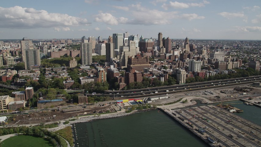4K stock footage aerial video of flying by skyscrapers, seen from East River, Brooklyn, New York Aerial Stock Footage | AX88_003