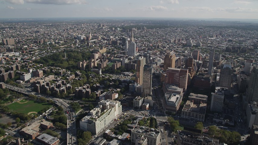4K stock footage aerial video of approaching Long Island University Brooklyn Campus and skyscrapers, Brooklyn, New York Aerial Stock Footage | AX88_008