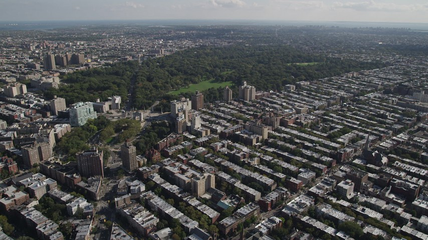 4K stock footage aerial video of flying over row houses toward Prospect Park, Grand Army Plaza, Brooklyn, New York Aerial Stock Footage | AX88_015