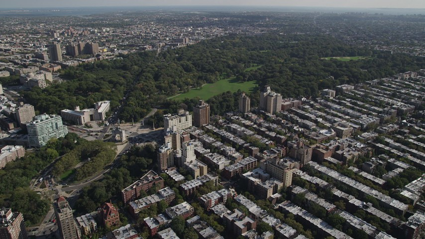 4K stock footage aerial video of approach Prospect Park and Grand Army Plaza from row houses, Brooklyn, New York Aerial Stock Footage AX88_016 | Axiom Images