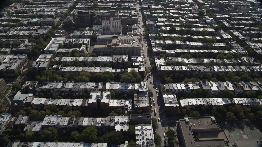 4K stock footage aerial video of flying over row houses in urban neighborhoods, Brooklyn, New York Aerial Stock Footage | AX88_017