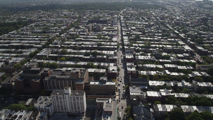4K stock footage aerial video of flying over row houses and city streets in Brooklyn, New York Aerial Stock Footage | AX88_018