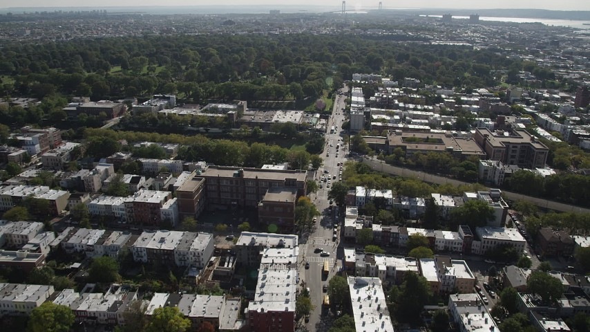 4K stock footage aerial video of flying over row houses, approaching Green-Wood Cemetery, Brooklyn, New York Aerial Stock Footage | AX88_021