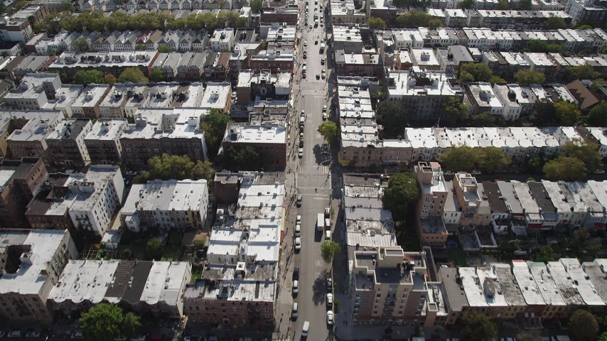 4K stock footage aerial video of following 8th Avenue past row houses, Brooklyn, New York Aerial Stock Footage | AX88_025