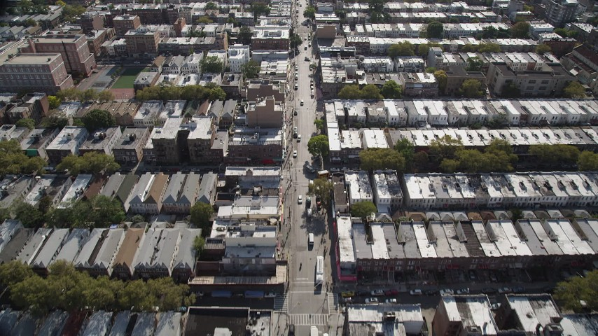 4K stock footage aerial video of flying over 8th Avenue and row houses, Brooklyn, New York Aerial Stock Footage | AX88_026