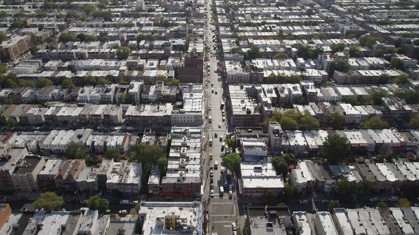 4K stock footage aerial video of flying over 8th Avenue and row houses, Brooklyn, New York Aerial Stock Footage | AX88_027