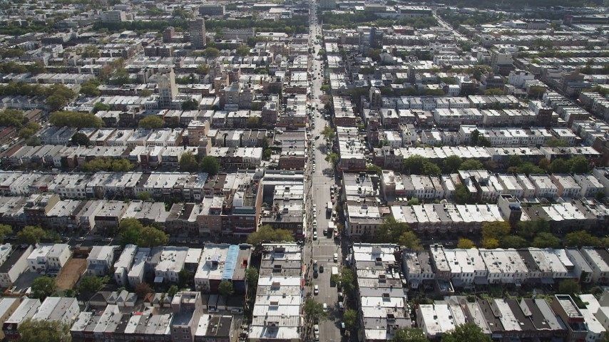4K stock footage aerial video of following 8th Avenue or urban row houses, Brooklyn, New York Aerial Stock Footage | AX88_028