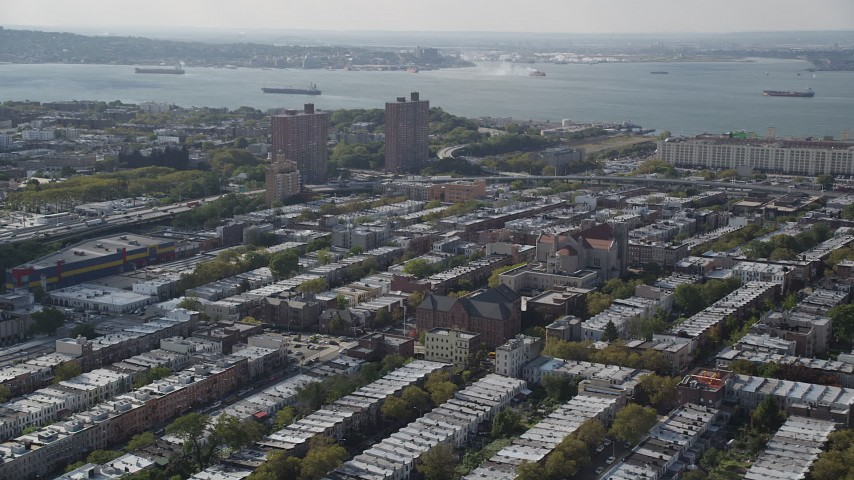 4K stock footage aerial video of the Basilica of Our Lady of Perpetual Help and row houses, Brooklyn, New York Aerial Stock Footage | AX88_029