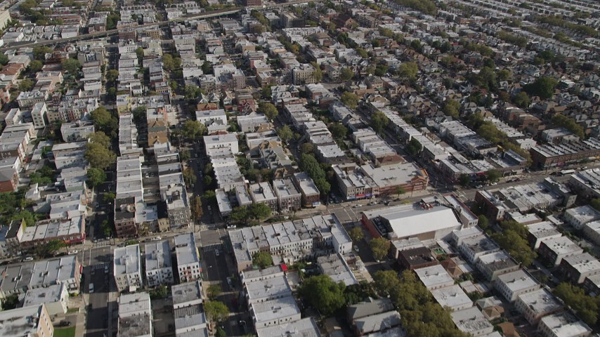 4K stock footage aerial video of flying over row houses, tilt up to wider view, Brooklyn, New York Aerial Stock Footage | AX88_032