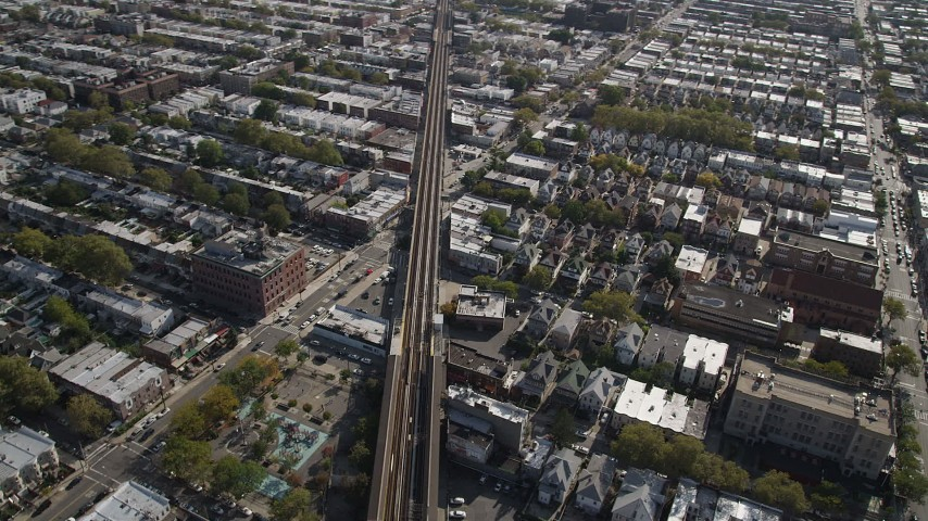 4K stock footage aerial video of flying by railroad tracks and row houses, Brooklyn, New York Aerial Stock Footage | AX88_034