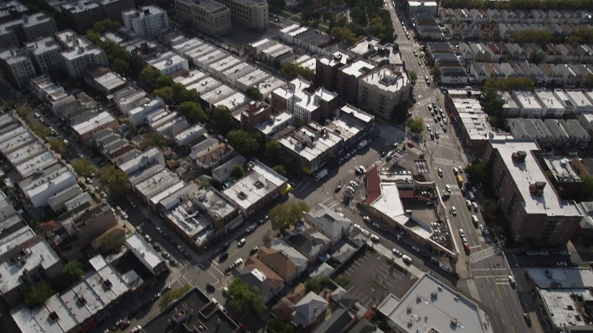 4K stock footage aerial video tilt from row houses to wider view of neighborhoods and apartment buildings, Brooklyn, New York Aerial Stock Footage   AX88_037