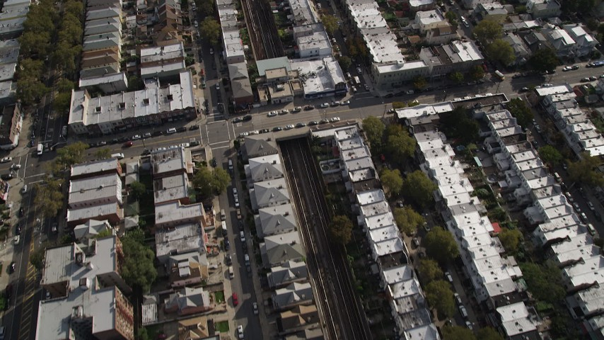 4K stock footage aerial video of following railroad tracks through an urban neighborhood, Brooklyn, New York Aerial Stock Footage | AX88_039