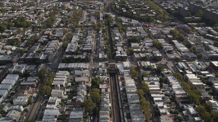 4K stock footage aerial video of following railroad tracks and flying over urban neighborhoods, Brooklyn, New York Aerial Stock Footage | AX88_040