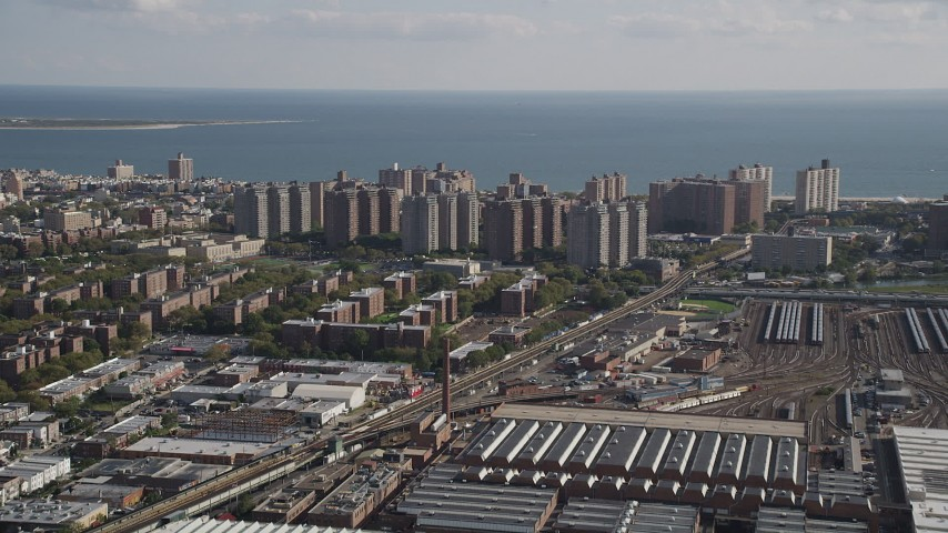 4K stock footage aerial video of approaching apartments on coast, Coney Island, Brooklyn, New York Aerial Stock Footage | AX88_041