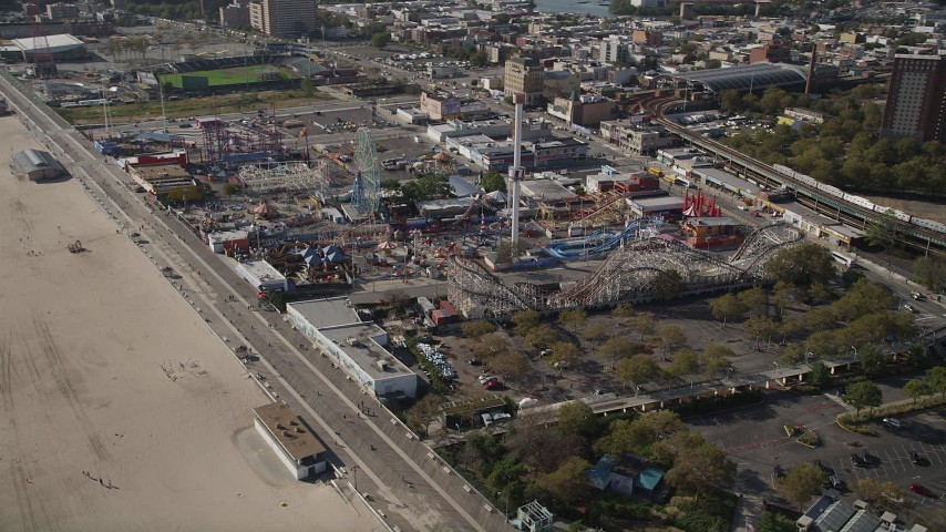 4K stock footage aerial video of flying by Luna Park rides in Coney Island, Brooklyn, New York City, New York Aerial Stock Footage | AX88_045