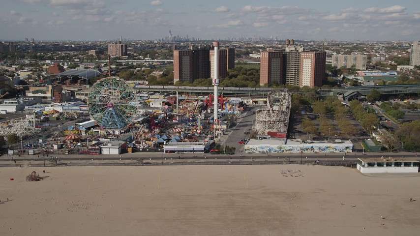 4K stock footage aerial video flyby a roller coaster and Ferris wheel at Luna Park, Coney Island, Brooklyn, New York Aerial Stock Footage | AX88_047