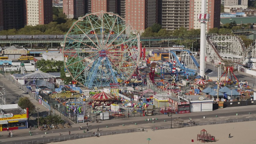 5k aerial video flyby Luna Park Ferris wheel, revealing roller coaster, Coney Island, Brooklyn, New York Aerial Stock Footage | AX88_048