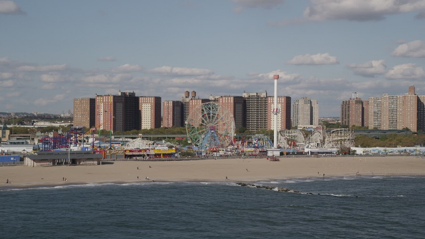 4K stock footage aerial video of flying by Luna Park and Coney Island Beach in Brooklyn, New York, New York Aerial Stock Footage AX88_055 | Axiom Images