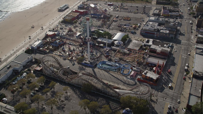 4K stock footage aerial video of flying by rides and beach at Luna Park in Coney Island, Brooklyn, New York, New York Aerial Stock Footage | AX88_057