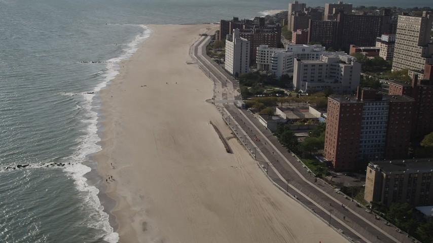 Flying by Coney Island Beach, Brooklyn, New York, New York Aerial Stock Footage | AX88_062