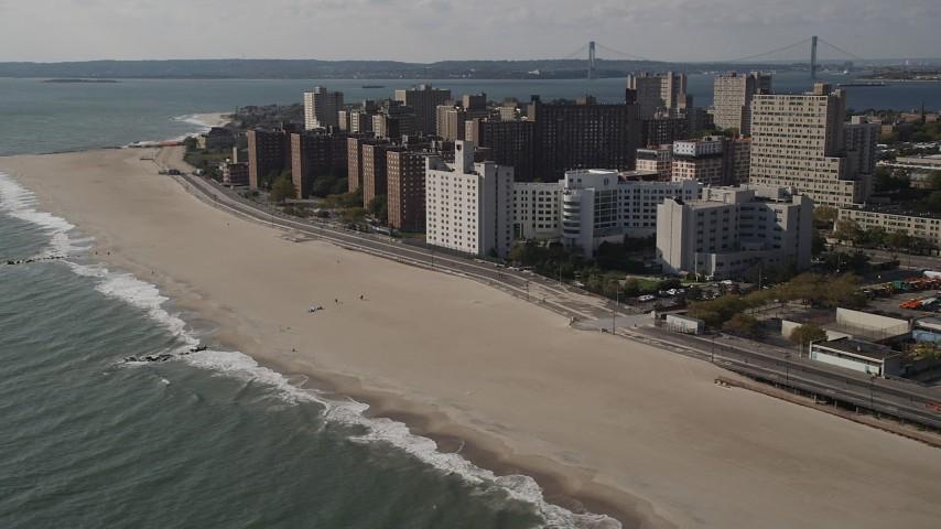 Flying by Coney Island Beach, Brooklyn, New York, New York Aerial Stock Footage | AX88_063