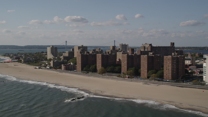 5k aerial video of beachfront apartment buildings by Coney Island Beach, Brooklyn, New York Aerial Stock Footage | AX88_064