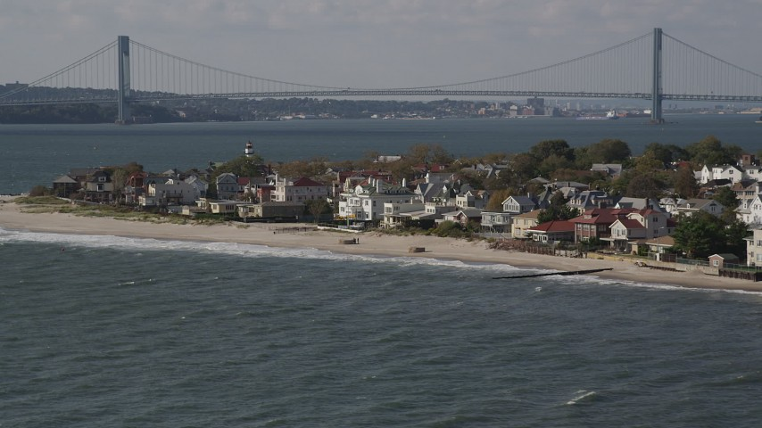 Flying by beachfront homes, Coney Island, Brooklyn, New York, New York Aerial Stock Footage | AX88_067