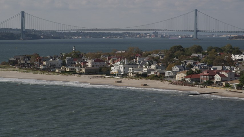 4K stock footage aerial video of passing by beachfront homes in Coney Island, Brooklyn, New York, New York Aerial Stock Footage | AX88_067