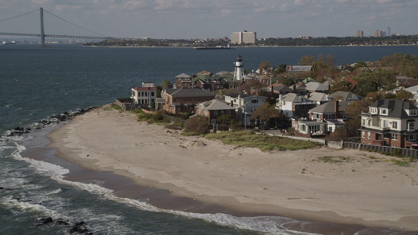Flying by beachfront homes, Coney Island, Brooklyn, New York, New York Aerial Stock Footage | AX88_070