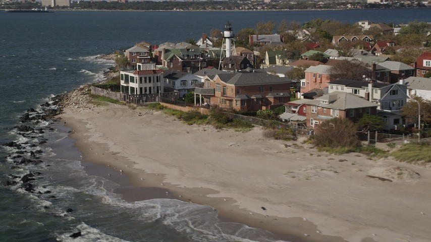 4K stock footage aerial video of beachfront homes by the ocean in Coney Island, Brooklyn, New York, New York Aerial Stock Footage | AX88_070