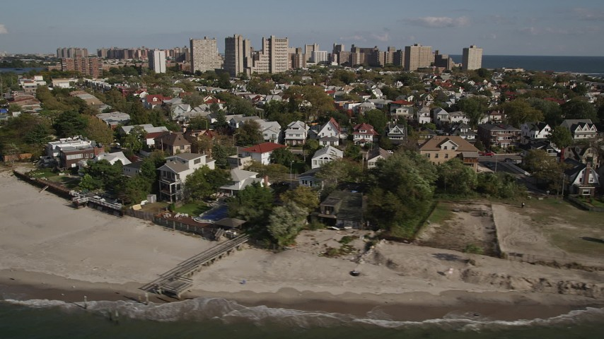 4K stock footage aerial video of flying by homes near the beach in Coney Island, Brooklyn, New York, New York Aerial Stock Footage | AX88_072