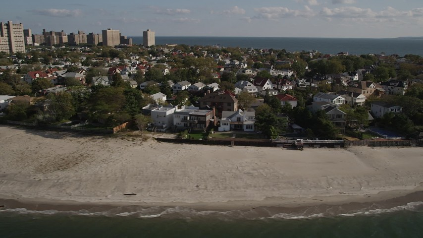 Flying by homes on the beach, Coney Island, Brooklyn, New York, New York Aerial Stock Footage | AX88_073