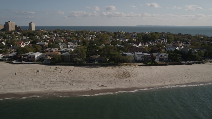 5k aerial video of flying away from homes on the beach in Coney Island, Brooklyn, New York, New York Aerial Stock Footage | AX88_073
