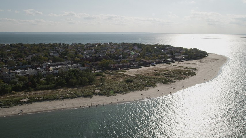 4K stock footage aerial video of flying by homes near the beach, Coney Island, Brooklyn, New York, New York Aerial Stock Footage | AX88_074