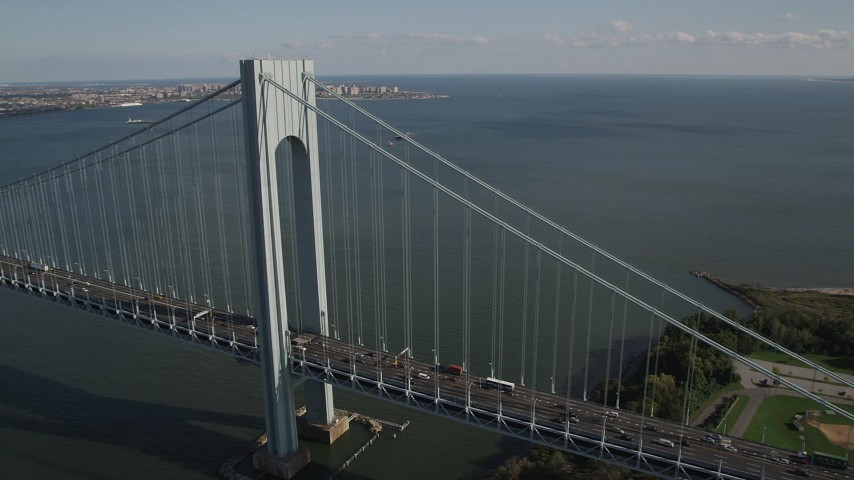 4K stock footage aerial video pan across Verrazano-Narrows Bridge, spanning The Narrows, New York Aerial Stock Footage | AX88_081