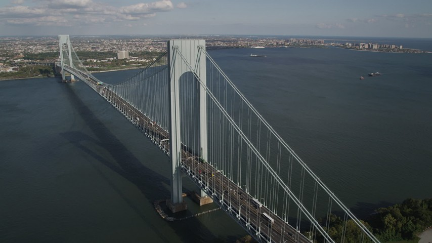 4K aerial stock footage video of passing by Verrazano-Narrows Bridge, seen from Staten Island, New York, New York Aerial Stock Footage | AX88_082