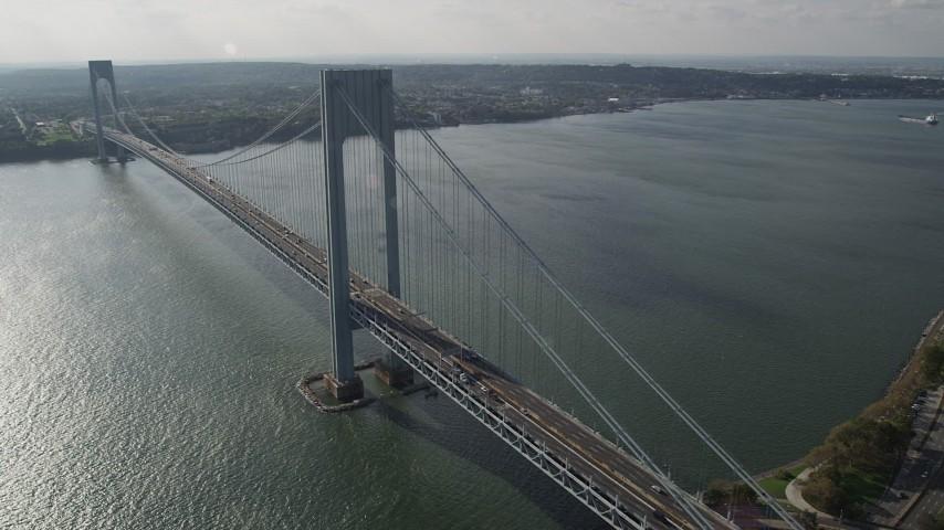 4K stock footage aerial video pan across Verrazano-Narrows Bridge, spanning The Narrows, New York, New York Aerial Stock Footage   AX88_087