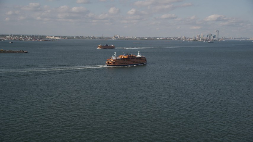 4K stock footage aerial video track a Staten Island Ferry sailing New York Harbor, New York, New York Aerial Stock Footage   AX88_092