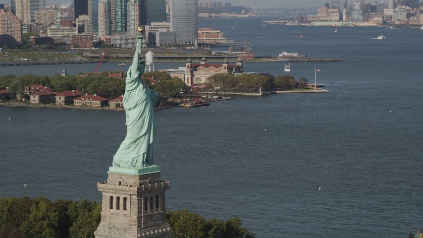 4K aerial video of flying by Statue of Liberty, with Ellis Island in background, New York, New York Aerial Stock Footage | AX88_098