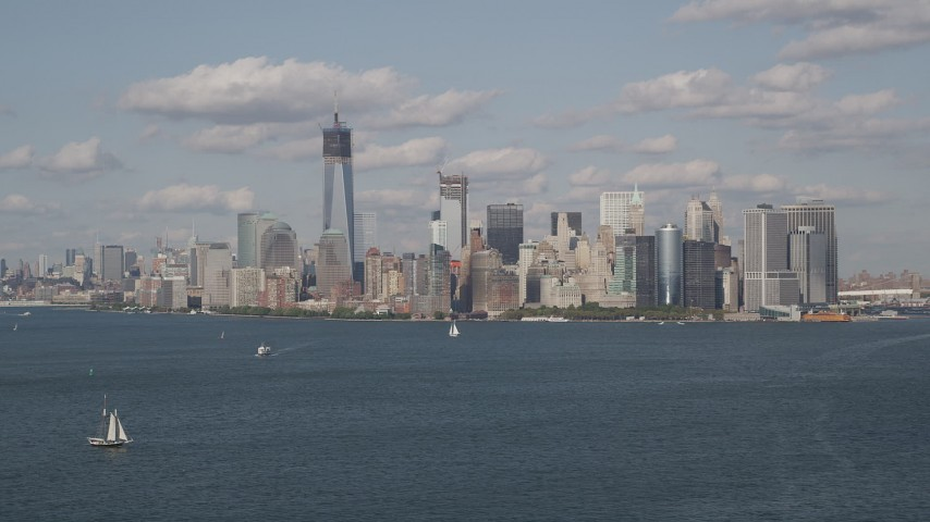4K stock footage aerial video of flying by Lower Manhattan, seen from New York Harbor, New York, New York Aerial Stock Footage | AX88_099