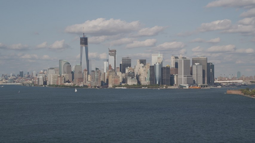 5K aerial video of the Lower Manhattan skyline, seen from New York Harbor, New York Aerial Stock Footage | AX88_100