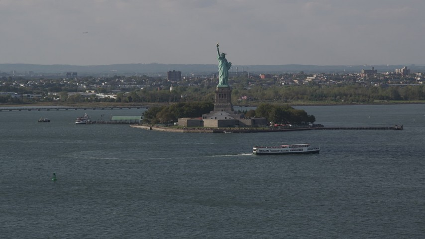 4K stock footage aerial video of flying by the front of the Statue of Liberty, New York, New York Aerial Stock Footage | AX88_101