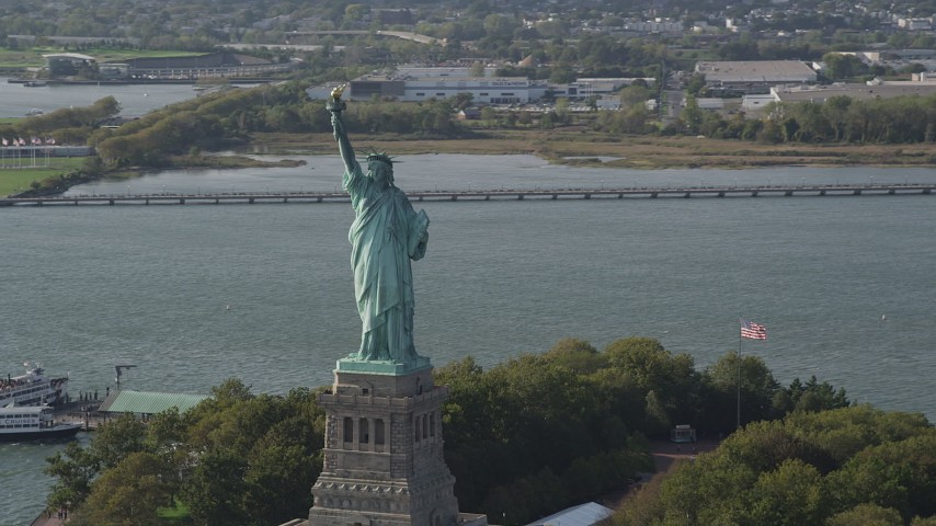 4K aerial video of flying by the front of the Statue of Liberty, New York, New York Aerial Stock Footage | AX88_104