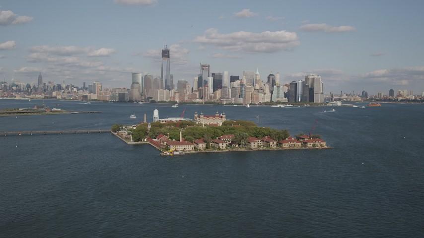 4K stock footage aerial video of flying by Ellis Island, Lower Manhattan skyline in background, New York, New York Aerial Stock Footage | AX88_111