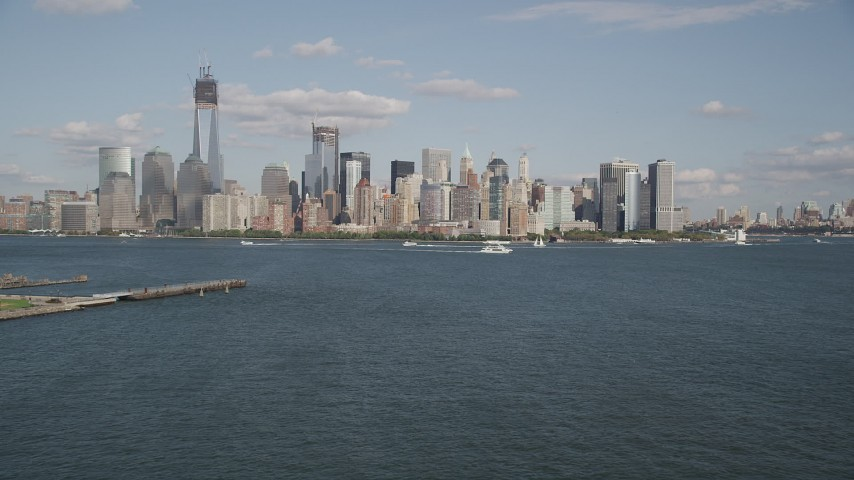 4K stock footage aerial video tilt up to approach Lower Manhattan skyline, New York, New York Aerial Stock Footage | AX88_113