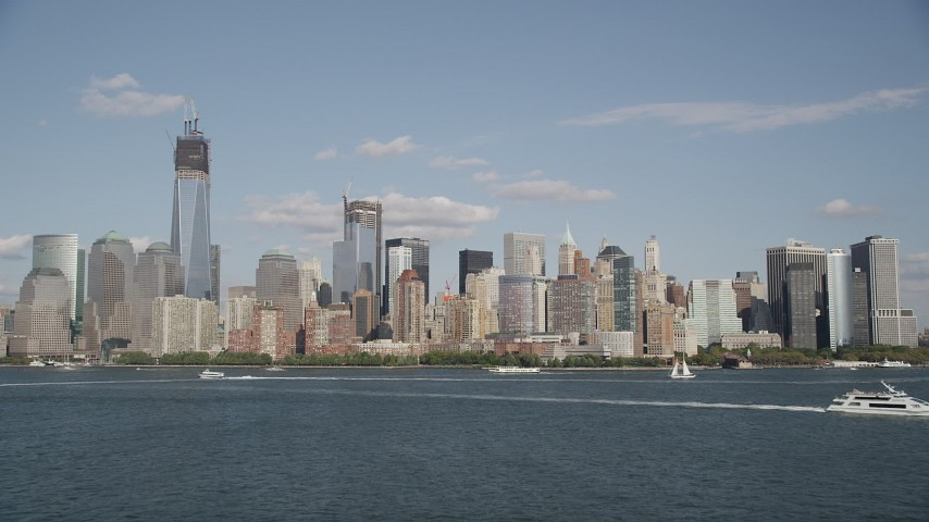 4K aerial video tilt up and approach the Lower Manhattan skyline, New York, New York Aerial Stock Footage | AX88_114