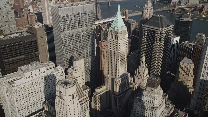 4K aerial stock footage video of approaching 40 Wall Street in Lower Manhattan, New York, New York Aerial Stock Footage | AX88_118