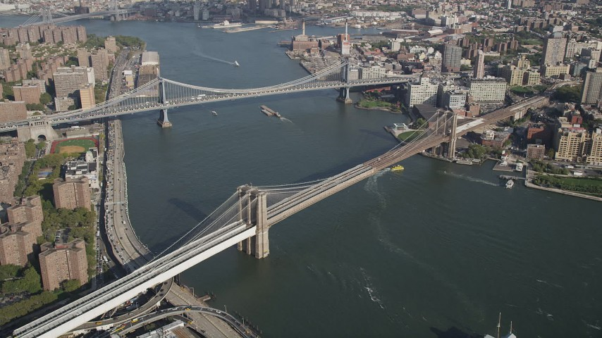 4K aerial video approach Brooklyn Bridge and Manhattan Bridge spanning East River, New York, New York Aerial Stock Footage AX88_120