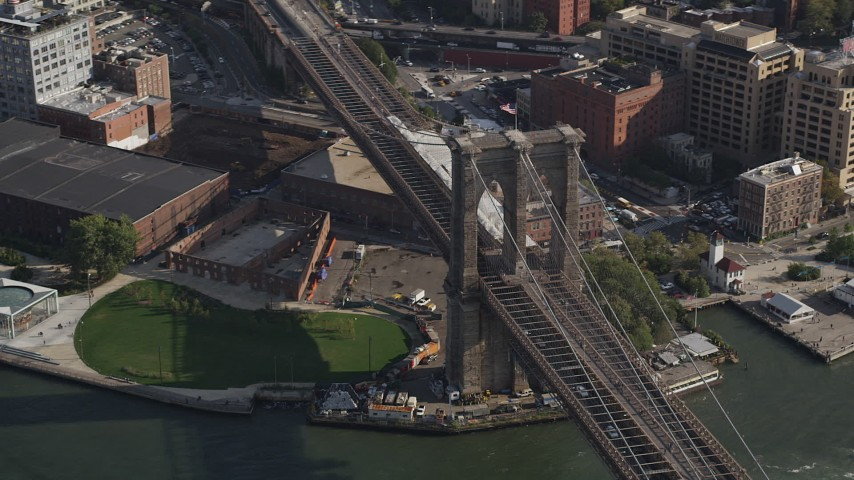 4K stock footage aerial video of flying by the historic Brooklyn Bridge, New York, New York Aerial Stock Footage | AX88_122
